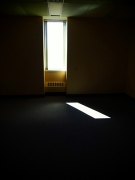 Thin window in a dark room.